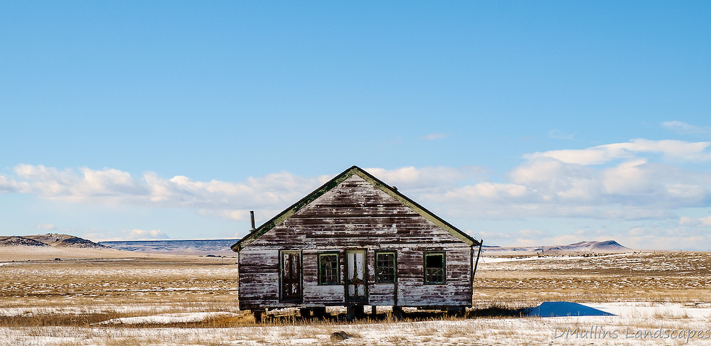 An old house sits decaying in a field in North East New Mexico.<br /> <br /> Available Sizes: 9x19, 18x36, Tri-Print (see Prints tab)