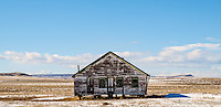 An old house sits decaying in a field in North East New Mexico.<br />