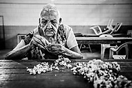 "BARQUISIMETO, VENEZUELA - JULY 28, 2016: Patients pick at blocks recycled material, breaking it into small pieces for hours a day. It is a low cost form of therapy that doctors at El Pampero invented to help psychiatric patients relieve their anxiety. Before the crisis, when patients were receiving all the medicines they needed - and the hospital had healthy government funding, they had a much more robust therapy program.  They held weekly sewing, cooking, and sculpture classes.  They had a farming program where patients grew fresh vegetables, and a sports program.  Now, there is no funding for any sort of therapy except picking at the blocks of recycled material, and unmedicated patients are too unstable to do those types of activities anymore.  ""When patients have their medicines, they can do really complex crafts. Now they just do simple tasks,"" said art therapist Mirthis Fernández.  PHOTO: Meridith Kohut for The New York Times"