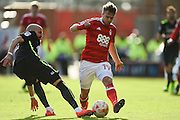Brighton & Hove Albion defender Bruno Saltor makes a tackle against Nottingham Forest forward Jamie Ward (19) during the EFL Sky Bet Championship match between Nottingham Forest and Brighton and Hove Albion at the City Ground, Nottingham, England on 4 March 2017. Photo by Jon Hobley.