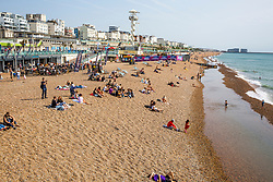© Licensed to London News Pictures. 19/09/2020. Brighton, UK. Only a handful of people take to the beach in Brighton And Hove as grey clouds hang over the seaside resort. Photo credit: Hugo Michiels/LNP