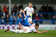 Jimmy Ryan of Rochdale is fouled by  Ross Sykes of Accrington during the EFL Sky Bet League 1 match between Rochdale and Accrington Stanley at the Crown Oil Arena, Rochdale, England on 12 October 2019.