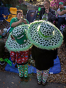 Shooting a photo of her son's, Laura Mazzara, left, waits of the St. Patrick's Day parade to start, Tuesday, March 17, 2015, in Savannah, Ga. The St. Patrick's Day tradition in Savannah dates back to the first parade held on March 17, 1824. (AP Photo/Stephen B. Morton)