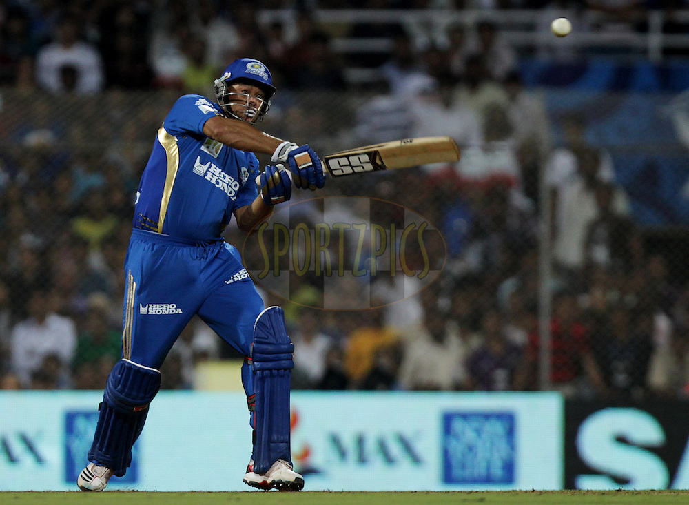 Mumbai Indian player Andrew Symonds bats during match 44 of the Indian Premier League ( IPL ) Season 4 between the Pune Warriors and the Mumbai Indians held at the Dr DY Patil Sports Academy, Mumbai India on the 4th May 2011..Photo by BCCI/SPORTZPICS.