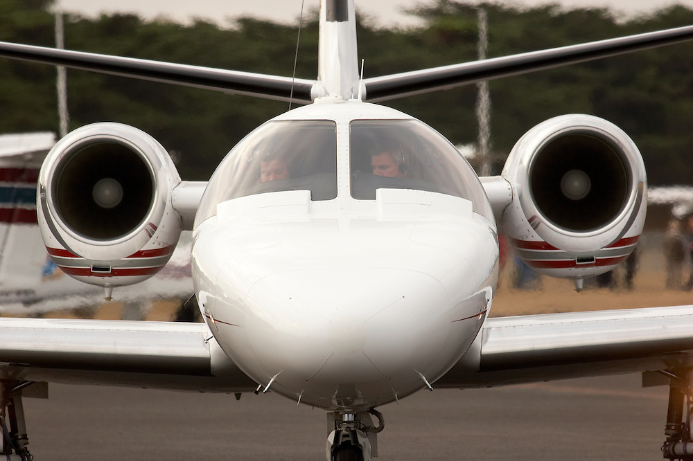 A Cessna Citation business jet with the engines running, preparing to taxi