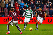 Celtic FC Defender Efe Ambrose on the attack against Hearts FC Forward Osman Sow during the Ladbrokes Scottish Premiership match between Heart of Midlothian and Celtic at Tynecastle Stadium, Gorgie, Scotland on 27 December 2015. Photo by Craig McAllister.