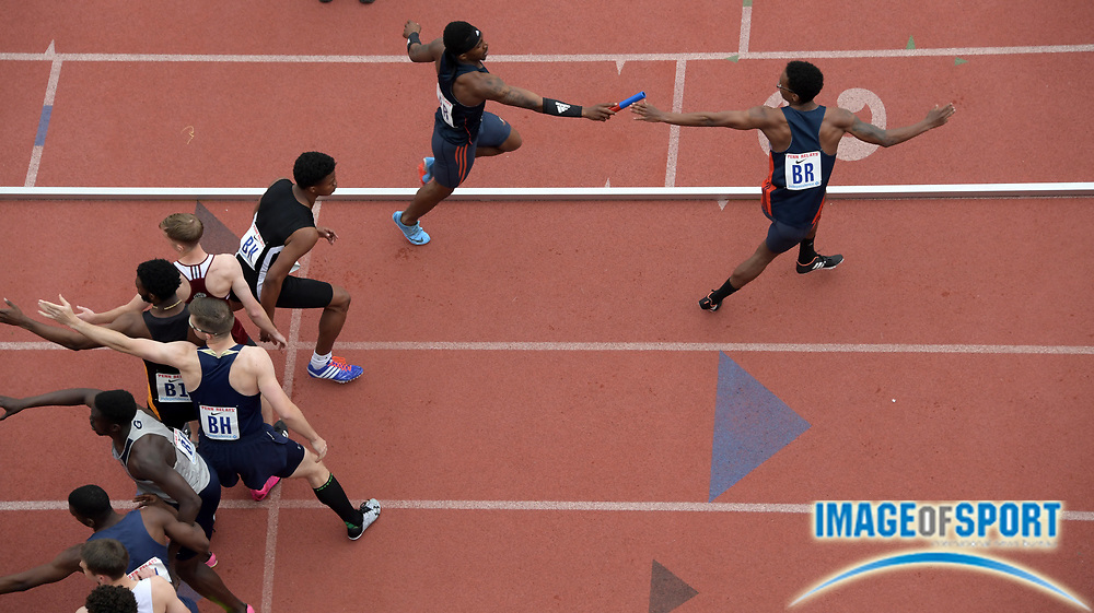 Apr 27, 2018; Philadelphia, PA, USA; Chiason Tenkiang takes the handoff from Akeem Bloomfield on the second leg of the Auburn 4 x 400m relay that ran the top qualifying time of 3:07.72 during the 124th Penn Relays at Franklin Field.