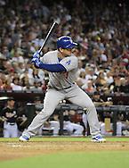 Jul 10, 2013; Phoenix, AZ, USA;  Los Angeles Dodgers infielder Nick Punto (7) at bat against the Arizona Diamondbacks at Chase Field.  The Dodgers defeated the Diamondbacks 7-5 in extra innings.  Mandatory Credit: Jennifer Stewart-USA TODAY Sports