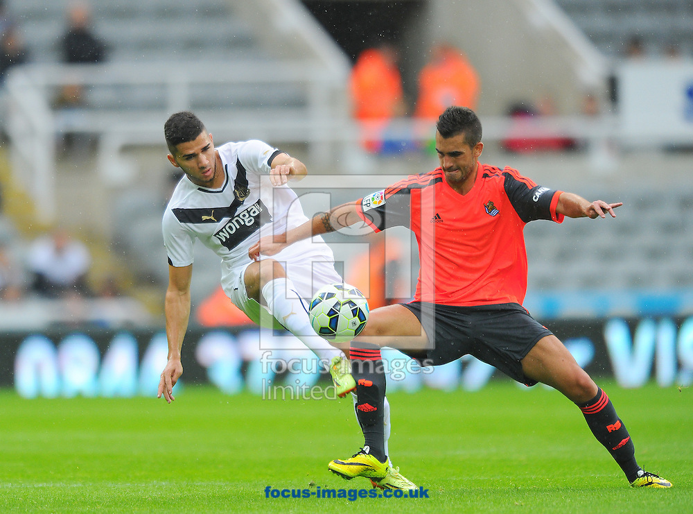 Mehdi Abeid of Newcastle United (left) battles with Alain Oyarzun of Real Sociedad during the pre season friendly match at St. James's Park, Newcastle<br /> Picture by Greg Kwasnik/Focus Images Ltd +44 7902 021456<br /> 10/08/2014