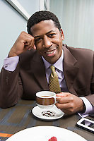 Businessman drinking coffee on business lunch