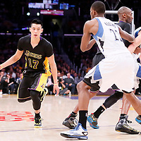 28 November 2014: Los Angeles Lakers guard Jeremy Lin (17) drives past Minnesota Timberwolves guard Zach LaVine (8) on a screen set by Los Angeles Lakers guard Kobe Bryant (24) during the Minnesota Timberwolves 120-119 victory over the Los Angeles Lakers, at the Staples Center, Los Angeles, California, USA.