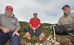 Feet First...<br /> Brendan Caufield Jimmy Connaugton and Michael Rattigan from Williamstown Co Galway taking a breather on their way to the summit of Croagh Patrick yesterday.