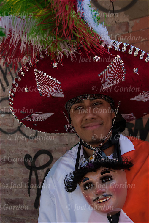 Portrait of Mexican Pride on Mothers Day at block party in West Village off 9th Avenue in New York City. <br /> <br /> Mexican American dressed in traditional Huehitzungo Carnival costumes and mask, shows his ethnic pride for Mexico.