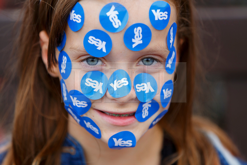 © Licensed to London News Pictures. 18/09/2014. Glasgow, UK. 'Rosie Gordon, 10, with Yes' voters and campaigners meeting at George Square in Glasgow whilst people of Scotland going to polling stations to vote on the Scottish independence referendum on Thursday, 18 September 2014. Photo credit : Tolga Akmen/LNP