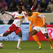 Bradley Wright-Phillips, New York Red Bulls, shoots past Jermaine Taylor, Houston Dynamo, during the New York Red Bulls V Houston Dynamo, Major League Soccer regular season match at Red Bull Arena, Harrison, New Jersey. USA. 23rd April 2014. Photo Tim Clayton