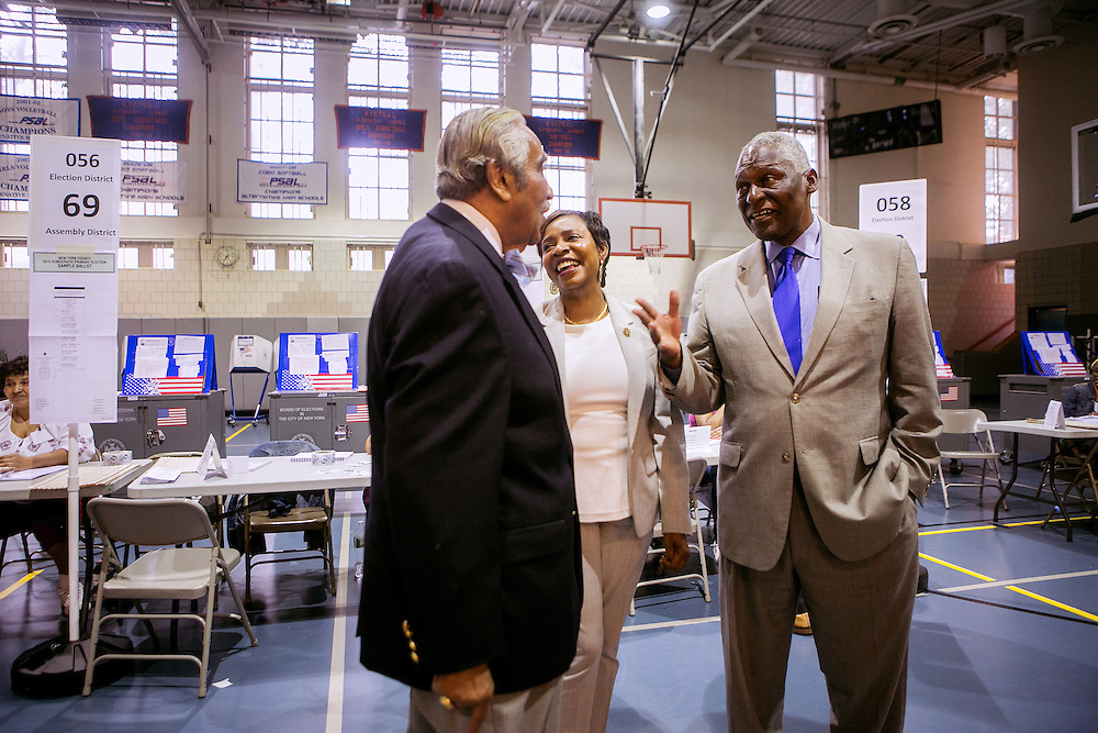 NEW YORK, NY - JUNE 28, 2016: Congressional candidate and New York State Assemblyman Keith Wright greets residents alongside Congresswoman Yvette Clarke and Congressman Charles Rangel at a polling place at West Side High School in New York, New York. CREDIT: Sam Hodgson for The New York Times.