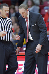 22 December 2013:  Dan Muller and referee Brent Hampton have a discussion during an NCAA  mens basketball game between the Blue Demons of DePaul falling to  the Illinois State Redbirds 69-64 in Redbird Arena, Normal IL