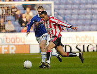 Photo: Leigh Quinnell.<br /> Leicester City v Southampton. The FA Cup. 28/01/2006.<br /> Leicesters Patrik Gerrbrand keeps an eye on Southamptons Dexter Blackstock.