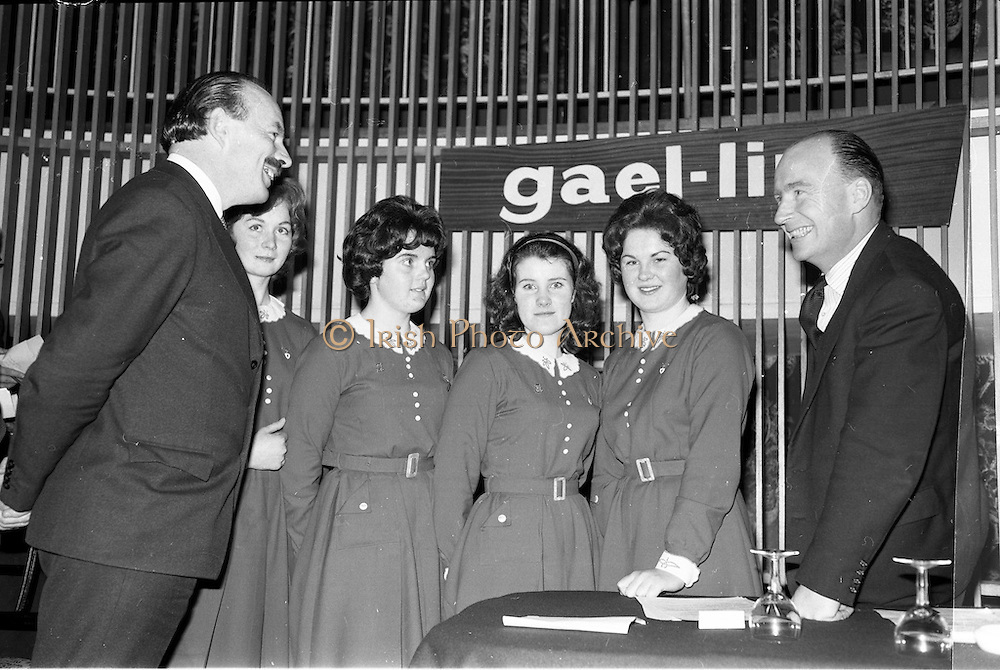 30/03/1963<br /> 03/30/1963<br /> 30 March 1963<br /> Gael - Linn Annual Debating Competition  for Secondary Schools awards presented at the Shelbourne Hotel, Dublin. Domhnall O'Morain (Chairman Gael Linn) and Dr. P. Hillery, Minister for Education, with members of the St. Louis Convent, Monaghan team. The team are (not in order): Maire Ni Ghadhra; Aine Ni Fhearraigh; Padraigin Ni Chumascaigh and Bernadette Ni Ghallchobhair.
