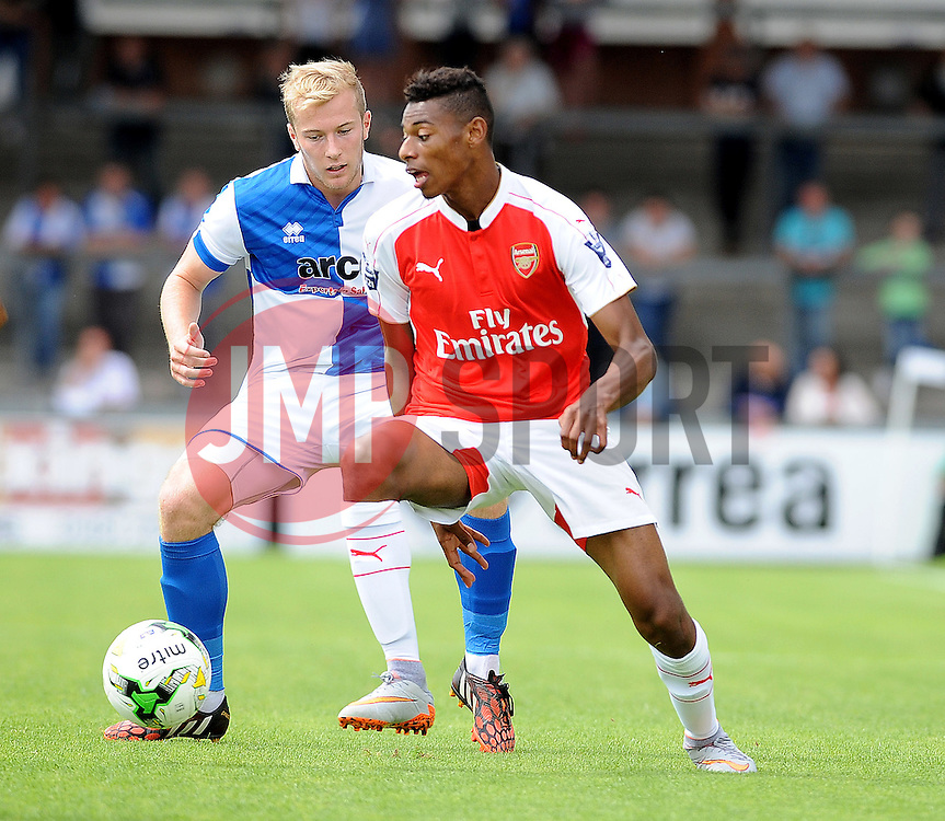 Danny Greenslade of Bristol Rovers challenges Arsenal's Tyrell Robinson - Photo mandatory by-line: Neil Brookman/JMP - Mobile: 07966 386802 - 18/07/2015 - SPORT - Football - Bristol - Memorial Stadium - Pre-Season Friendly