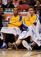 Feb. 10, 2011; Phoenix, AZ, USA; Golden State Warriors guard Monta Ellis (left) and teammate forward David Lee react from the bench against the Phoenix Suns at the US Airways Center. The Suns defeated the Warriors 112 - 88. Mandatory Credit: Jennifer Stewart-US PRESSWIRE