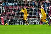 Marvin Bartley (#6) of Livingston FC runs to celebrate after scoring a goal during the Ladbrokes Scottish Premiership match between Heart of Midlothian FC and Livingston FC at Tynecastle Park, Edinburgh, Scotland on 4 December 2019.
