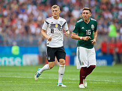 MOSCOW, RUSSIA - Sunday, June 17, 2018: Germany's Toni Kroos and Mexico's Hector Herrera during the FIFA World Cup Russia 2018 Group F match between Germany and Mexico at the Luzhniki Stadium. (Pic by David Rawcliffe/Propaganda)