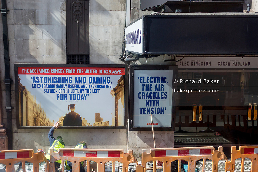 Workmen make repairs outside the Whitehall Theatre in Westminster, on 26th March 2019, in London, England
