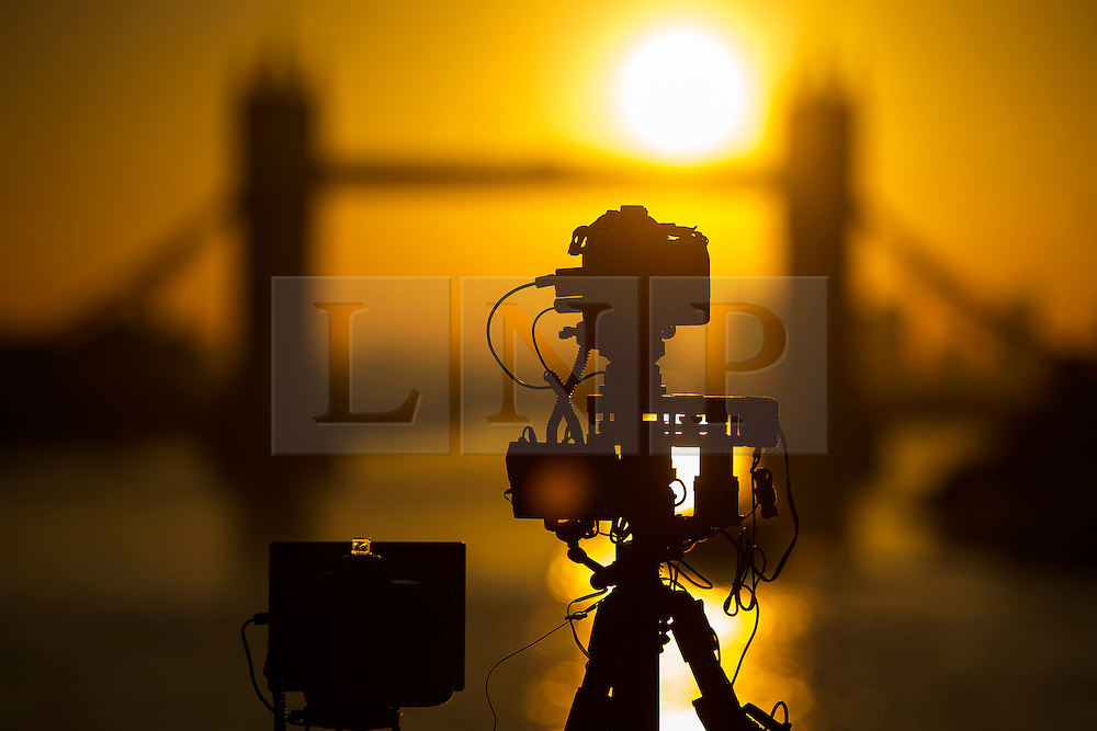 © Licensed to London News Pictures. 16/02/2016. London, UK. A camera pointed at the sun rising behind Tower Bridge in central London on a cold winter morning. Temperatures in the capital dropped below zero last night. Photo credit: Ben Cawthra/LNP