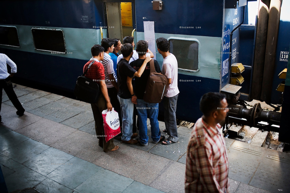 Passengers check the confirmed passenger's list of the Himsagar Express 6317 after it pulls in to the Jammu Tawi station from Kanyakumari on 6th July 2009.. .6318 / Himsagar Express, India's longest single train journey, spanning over 3720 kms, going from the mountains (Hima) to the seas (Sagar), from Jammu and Kashmir state in the Indian Himalayas to Kanyakumari, the southern-most tip of India..Photo by Suzanne Lee / for The National.