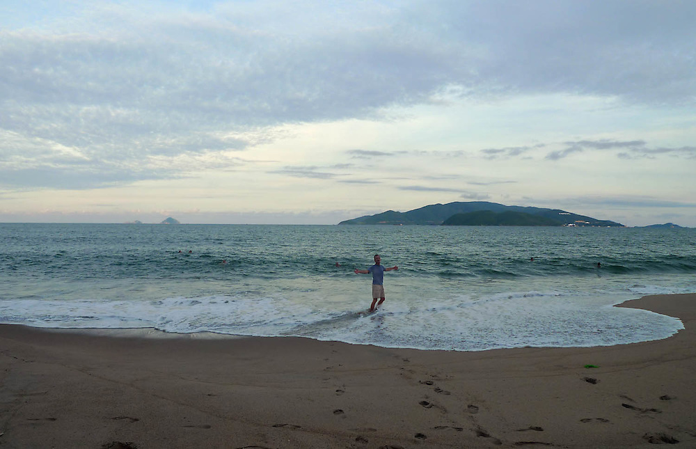 "Tom Saal, of Akron, goes for a swim in the East Sea in Nha Trang.  After returning to Vietnam, Saal says, ""I definitely smile more than I used to.""  (Laura FongTorchia/Special to the Akron Beacon Journal)"