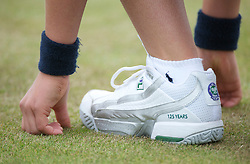 LONDON, ENGLAND - Saturday, June 25, 2011: A FILA tennis shoe of a ball boy during the Ladies' Singles 3rd Round match on day six of the Wimbledon Lawn Tennis Championships at the All England Lawn Tennis and Croquet Club. (Pic by David Rawcliffe/Propaganda)