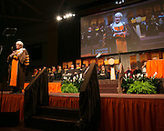 RIT President Dr. William Destler speaks (and simultaneously signs in American Sign Language) at RIT's Convocation Ceremony in Rochester on Friday, May 22, 2015.