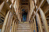 SAN RAMON, CA - DECEMBER 28:   A worker carries a roll of wire upstairs to install on a new home on December 28, 2007 in San Ramon, California. The Commerce Department reported December 28 that the sales of new homes in the US dropped to the lowest level in 12 years for the month of November.  (Photograph by David Paul Morris)