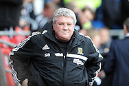 Hull city manager Steve Bruce looks on before k/o. Barclays Premier league, Cardiff city v Hull city match at the Cardiff city Stadium in Cardiff, South Wales on Saturday 22nd Feb 2014.<br /> pic by Andrew Orchard, Andrew Orchard sports photography.