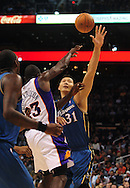 Dec. 5 2010; Phoenix, AZ, USA; Phoenix Suns guard Jason Richardson (23) makes a pass over Washington Wizards forward Yi Jianlian (31) during the second half at the US Airways Center. The Suns defeated the Wizards 125-108. Mandatory Credit: Jennifer Stewart-US PRESSWIRE.
