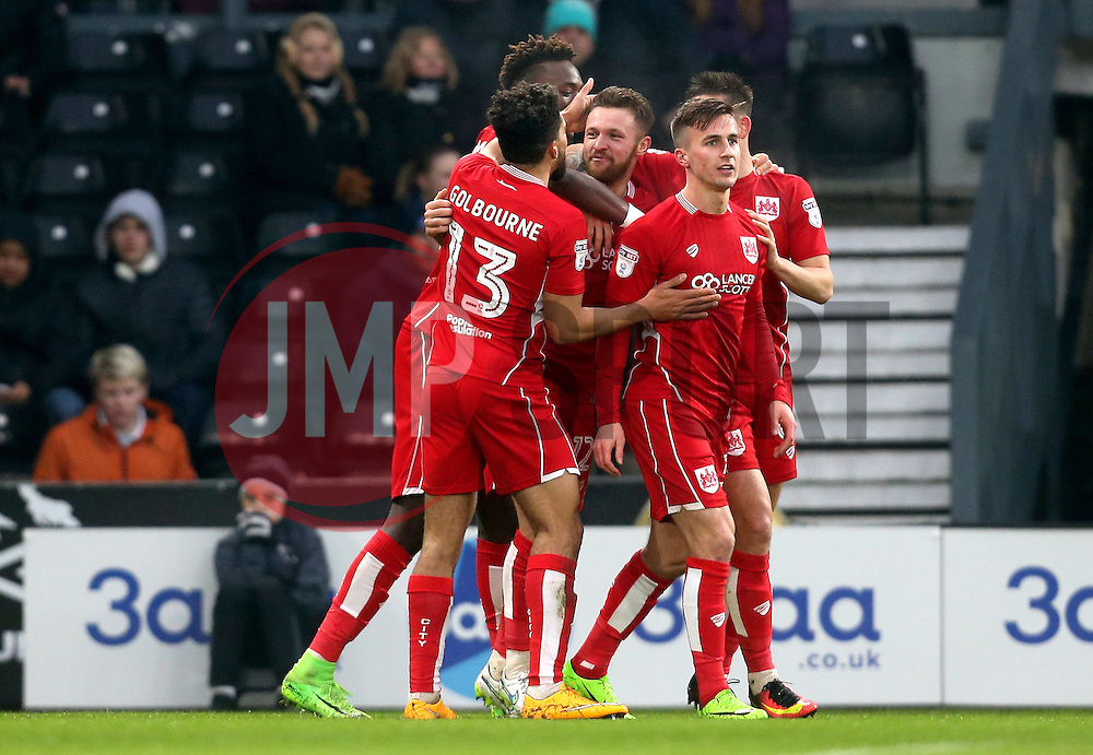 Matty Taylor of Bristol City celebrates with teammates after scoring his first goal for the club - Mandatory by-line: Robbie Stephenson/JMP - 11/02/2017 - FOOTBALL - iPro Stadium - Derby, England - Derby County v Bristol City - Sky Bet Championship