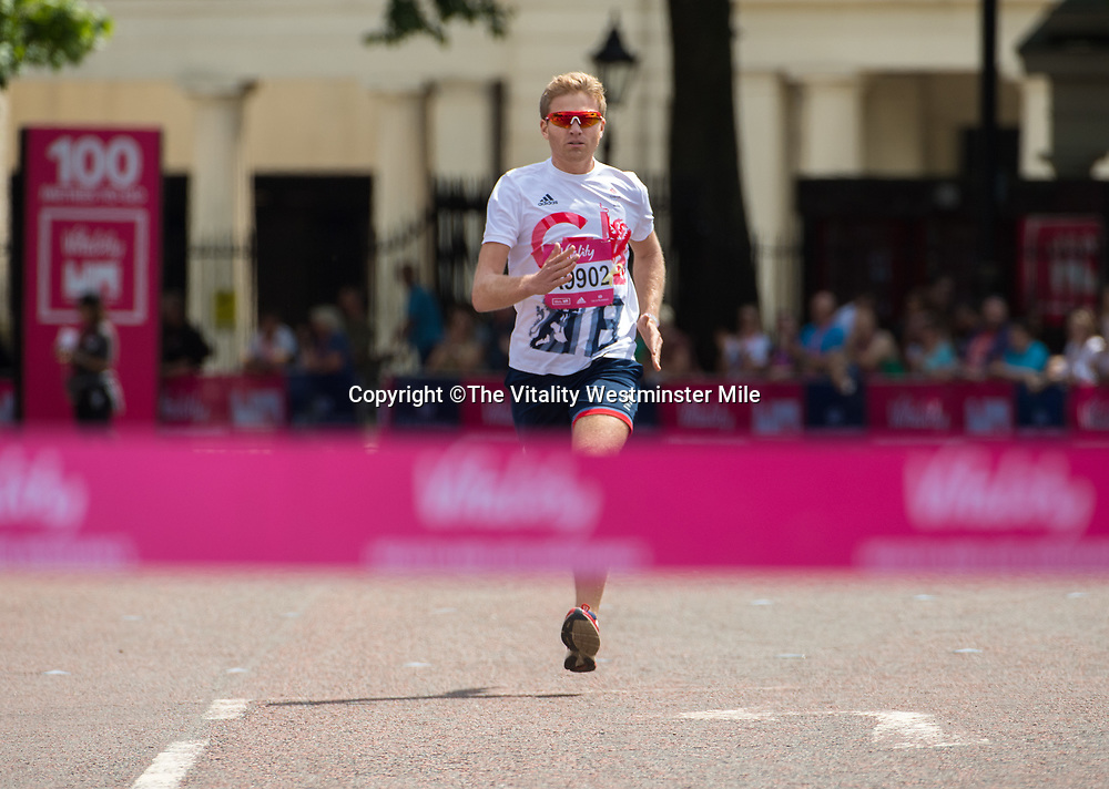 Constantine Louloudis the winner of the Olympians race at the finishing line outside Buckingham Palace at The Vitality Westminster Mile, Sunday 28th May 2017.<br /> <br /> Photo: Thomas Lovelock for The Vitality Westminster Mile<br /> <br /> For further information: media@londonmarathonevents.co.uk