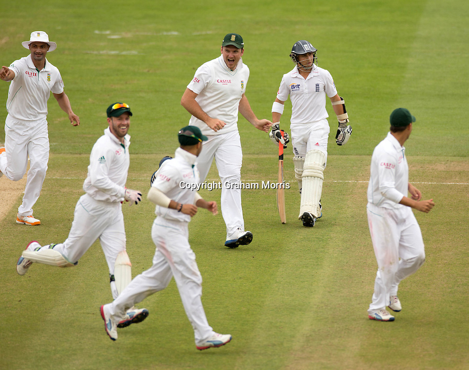 Celebrations as James Taylor (facing) is run out on the last day of the third and final Investec Test Match between England and South Africa at Lord's Cricket Ground, London. Photo: Graham Morris (Tel: +44(0)20 8969 4192 Email: sales@cricketpix.com) 20/08/12