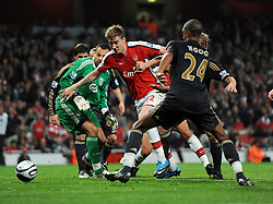 Nicklas Bendtner of Arsenal takes on Liverpool goalkeeper Diego Cavalieri and Dirk Kuyt. Arsenal v Liverpool (2-1), The Carling Cup 4th Round, Emirates Stadium, London, 28th Oct 2009.