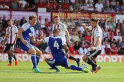Ipswich defender and captain Luke Chambers (4) tackling Brentford forward Scott Hogan (9)  during the EFL Sky Bet Championship match between Brentford and Ipswich Town at Griffin Park, London, England on 13 August 2016. Photo by Matthew Redman.