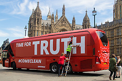"Old Palace Yard, Westminster, July 18th 2016. Greenpeace protest against the ""exaggeration and lies"" of the Vote Leave campaign in the EU referendum by taking over they campaign's bus on which was emblazoned the promise of an extra £350 million for the NHS, which days after the referendum Brexit campaigners distanced themselves from. Covering the cuts in ""Time for Truth"" made up of hundreds of questions from members of the public, the bus, parked outside Parliament is a stark admonishment against dishonest politics."