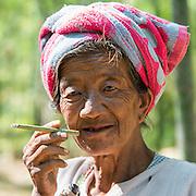 Myanmar/Burma. Inle Lake. A local woman smoking a cheroot/cigar.