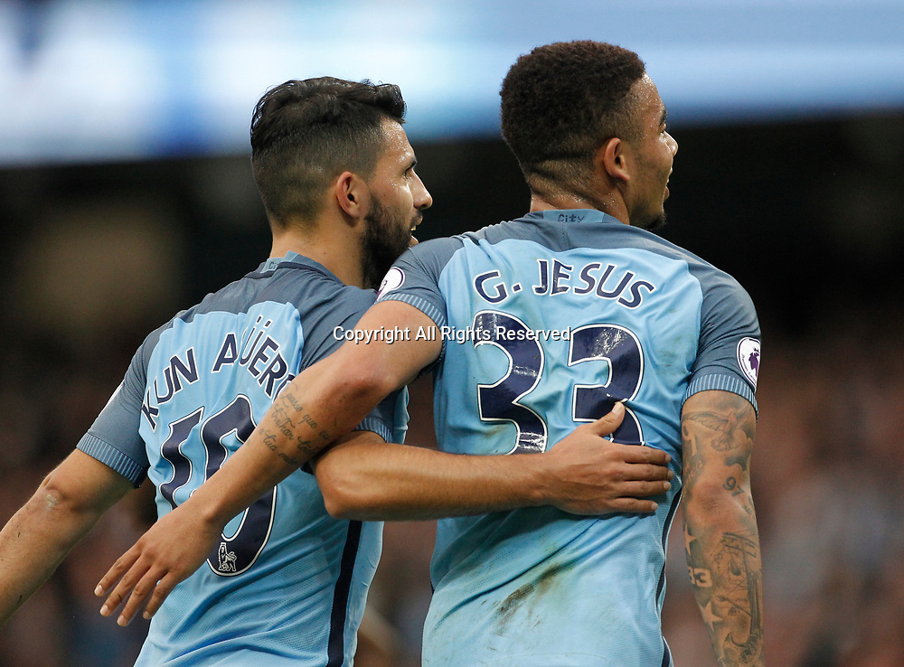 May 16th 2017, Etihad Stadium, Manchester, England; EPL Premier League football, Manchester City versus West Bromwich Albion; Sergio Aguero congratulates Gabriel Jesus after Jesus had put City 1-0 ahead after 27 minutes