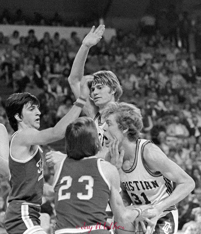 Holy Family baskball player claws his Denver Christian Academy opponent during the 1974 Class AA Colorado State High School championship game, won by Holy Family, 71-60