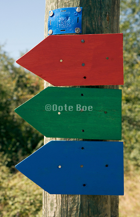 direction signs for various walking trails