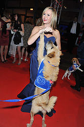 AMANDA HOLDEN and Billy the dog at the Battersea Dogs & Cats Home Collars & Coats Gala Ball held at Battersea Evolution, Battersea Park, London SW8 on 8th November 2012.