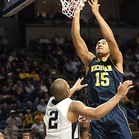 Michigan's Jon Horford (1) lays in a basket during the second half of an NCAA college basketball game in University Park, Pa., Wednesday, Feb. 27, 2013.