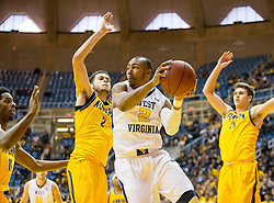 Dec 5, 2015; Morgantown, WV, USA; West Virginia Mountaineers guard Jevon Carter (2) passes to a teammate during the second half against the Kennesaw State Owls at WVU Coliseum. Mandatory Credit: Ben Queen-USA TODAY Sports