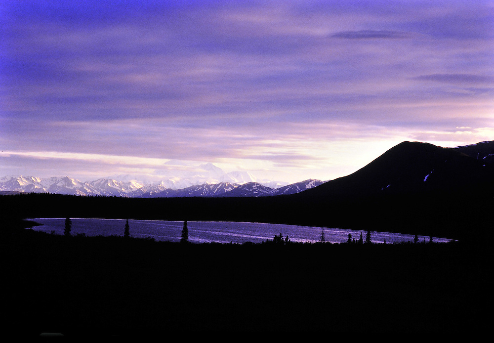 An unidentified Alaskan lake in the foreground and Denali Mountain in the background. Alaska